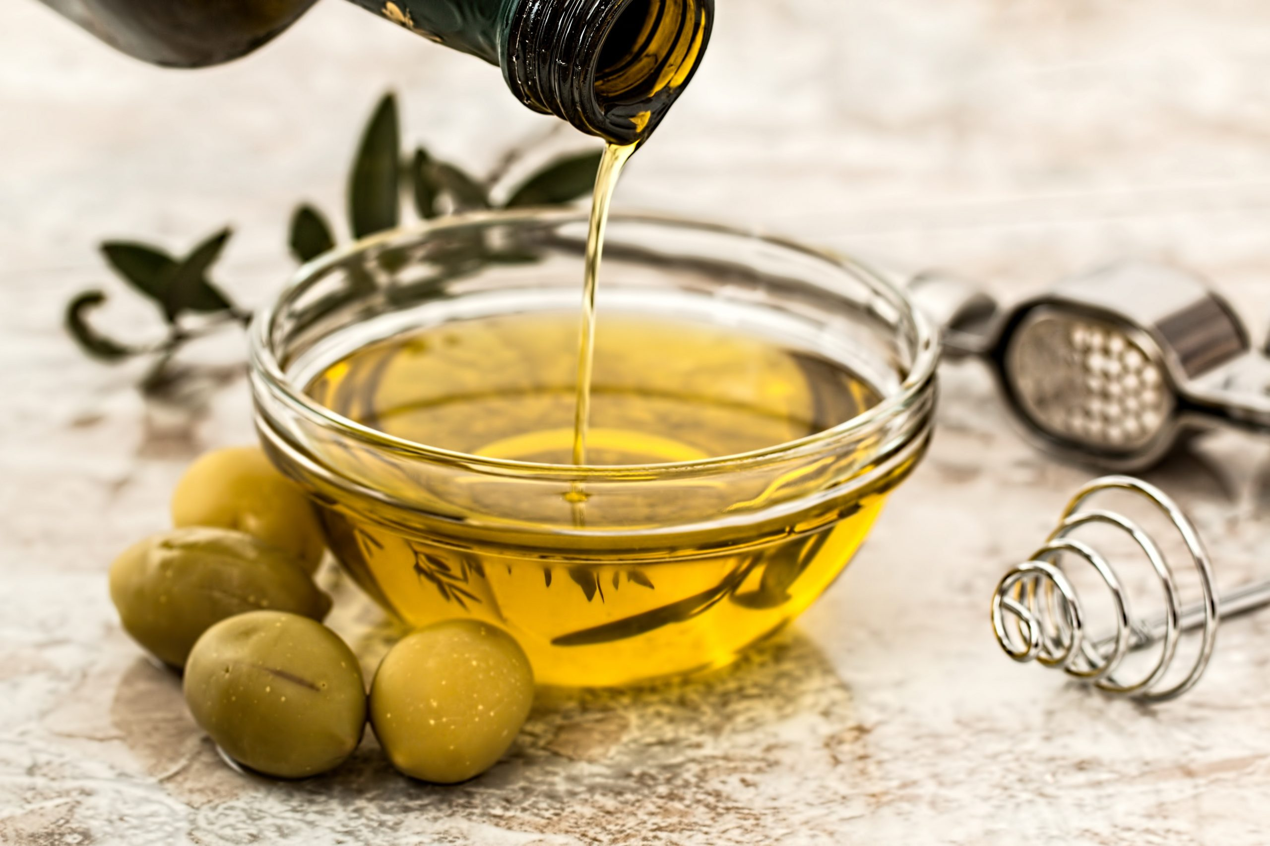 olive oil poured into bowl